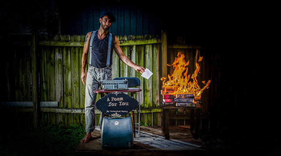 Man standing on barbecue grill