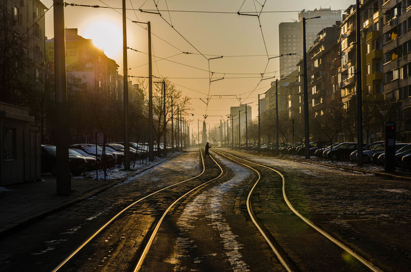 Street Architecture Building Exterior Built Structure Cable City Clear Sky Day Electricity Pylon Love Yourself No People Outdoors Rail Transportation Railroad Track Railway Track Sky Sunset The Way Forward Transportation Tree