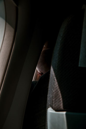 intimate moments Passenger Plane Plane Seat People In Transit Real People Illuminated Light Light And Shadow Airplane Close-up Close Up Close-up
