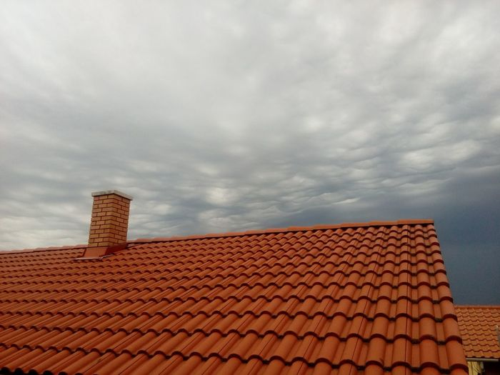 The storm is coming Clouds House-top Roof Roofs Sky Stormclouds Tile Tiles