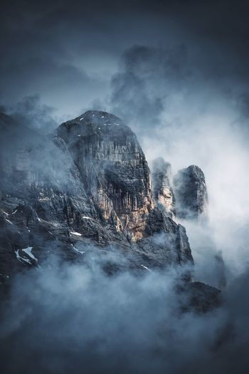 Scenic View Of Dolomites Covered With Fog Against Sky