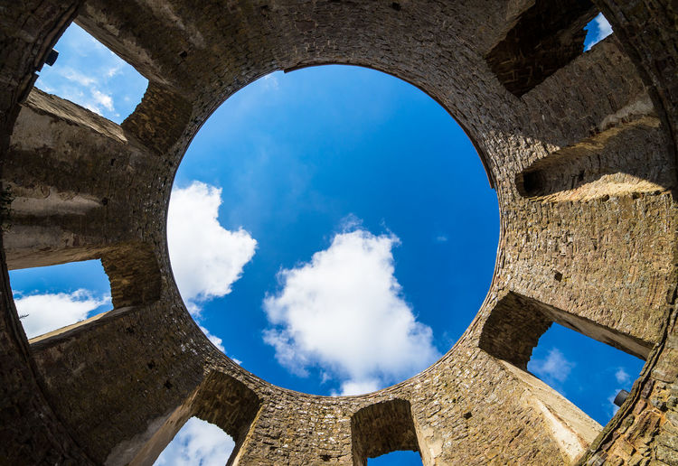Low angle view of blue sky seen through arch