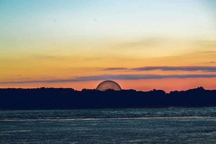 Silhouette of ferris wheel at sunset
