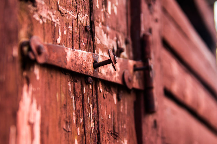 Close-Up Of Rusty Door Of Abandoned House