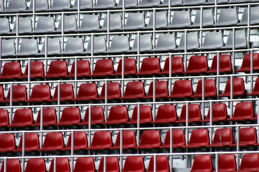 Red Backgrounds No People Sport Close-up Seats Available Seats STAND Red And Gray Stadium Soccer Sport Spectators