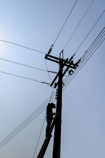 High work, cable work Cable Clear Sky Complexity Connection Day Electricity  Electricity Pylon Fuel And Power Generation Low Angle View Nature No People Power Line  Power Supply Silhouette Sky Technology Telephone Line Working