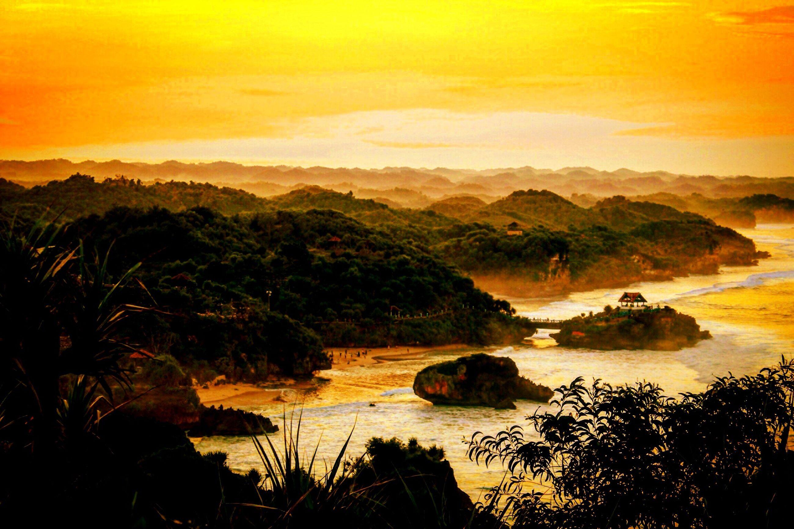 tranquil scene, sunset, scenics, tranquility, beauty in nature, water, nature, sky, sea, rock - object, idyllic, rock formation, landscape, orange color, non-urban scene, silhouette, cliff, rock, mountain, remote