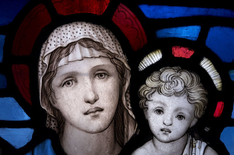 Saint Mary and baby Jesus depicted on a stained glass window in Gloucester Cathedral cloister, England Human Representation Art And Craft Creativity Representation Male Likeness Headshot Close-up Portrait Indoors  Female Likeness Craft People Two People Men Day Human Face Mary And Jesus Saint Mary Baby Jesus Stained Glass Window