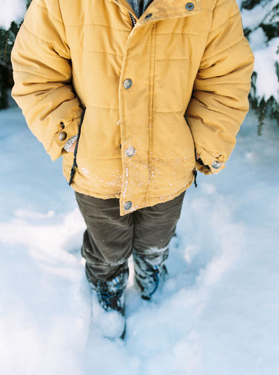 Man standing on snow covered field