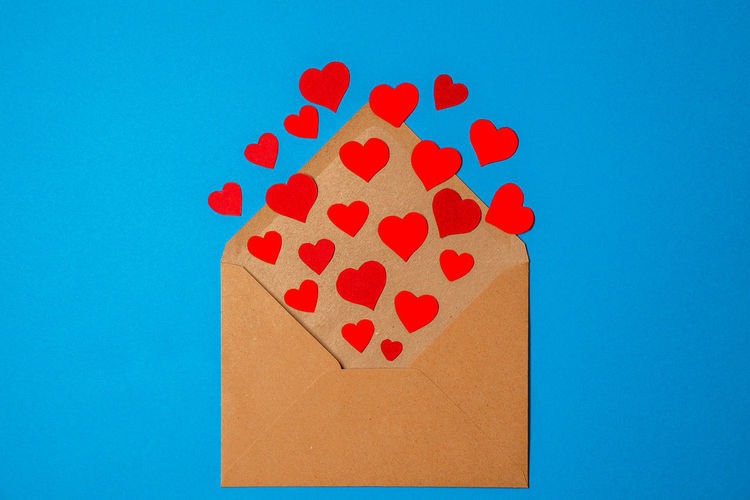 Close-up of heart shape against blue background