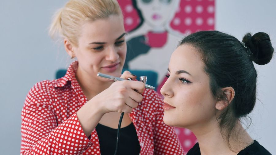 Make-up Two People Women Beauty Females Young Women Applying Young Adult People Indoors  Adult Only Women Hair Salon Adults Only Beauty Salon Makeup Airbrushed Working Airbrushing Airbrush Businesswoman Saloon Beautiful Woman Blond Hair Cooperation