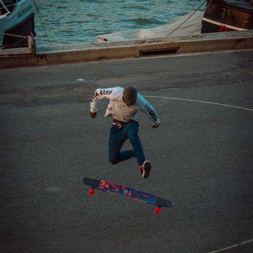 Full length of girl jumping