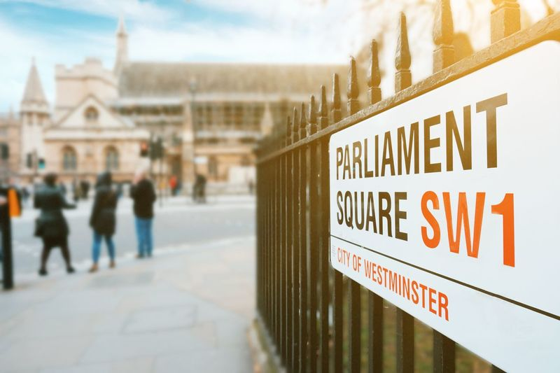 Parliament Square London Government Brexit Railing Street Sign London Parliament Square Houses Of Parliament - London Parliament Parliament Building Text Communication Western Script Sign Focus On Foreground Incidental People Architecture