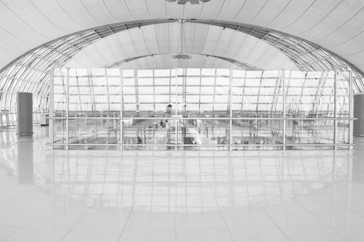 architecture Suvarnabhumi airport - Bangkok - Thailand Indoors  Reflection Flooring Built Structure Architecture Airport Real People Tile Tiled Floor Transportation Men Travel Glass - Material Group Of People Modern Arch People Day Walking Ceiling