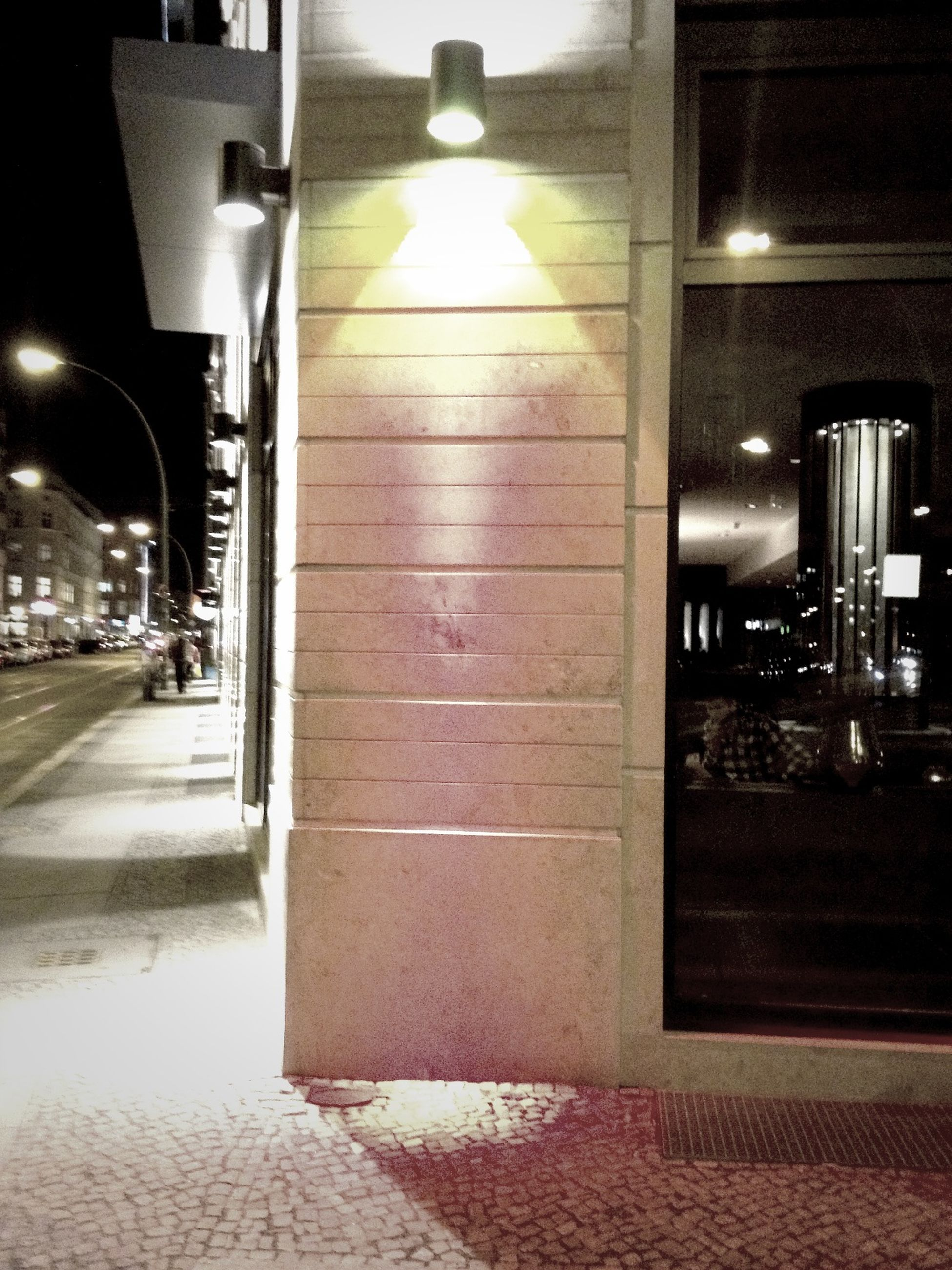 illuminated, architecture, built structure, night, building exterior, city, lighting equipment, architectural column, empty, indoors, incidental people, the way forward, building, transportation, street light, no people, street, absence, column, city life