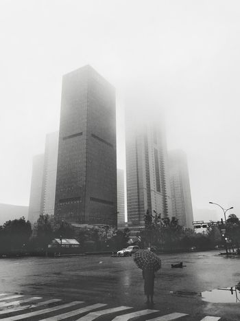 Black & White Architecture Skyscraper Modern Outdoors Real People Clear Sky Day City Built Structure One Person OpenEdit Black And White Architecture Sculpture EyeEm Gallery Chinese EyeEm Best Edits
