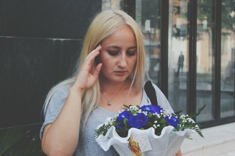 Beautiful Young Woman Holding Flower Bouquet
