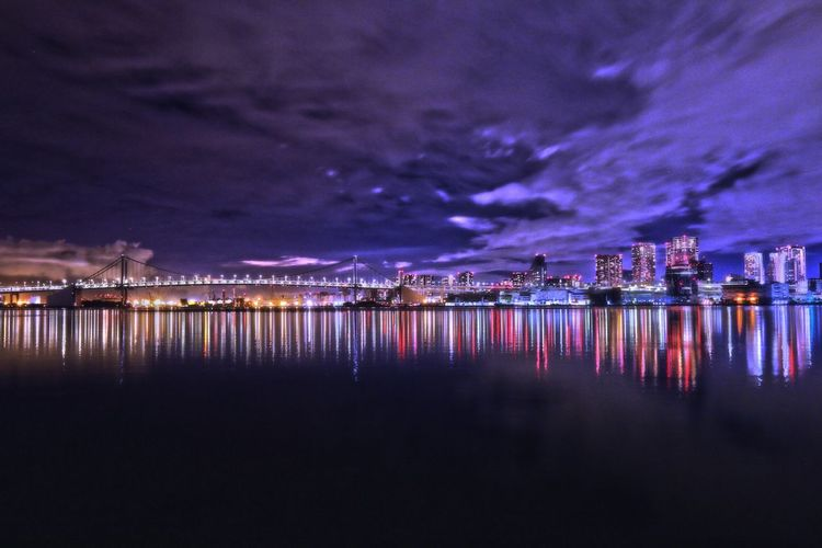 Illuminated Reflection Water Night Waterfront Architecture Built Structure City Building Exterior Sky Tranquility Light Scenics Tranquil Scene No People City Life Cloud - Sky Water Surface Sea In Front Of