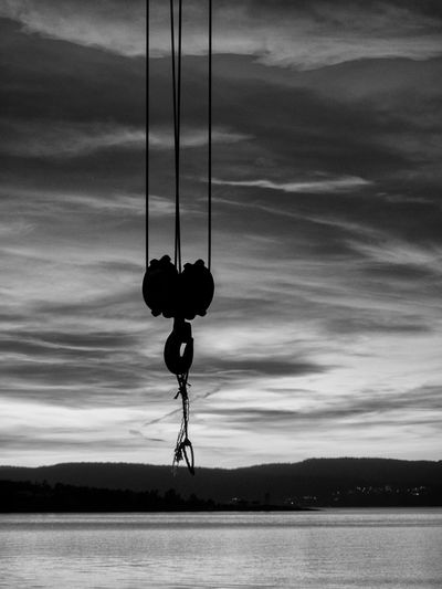 Hook from abandoned crane, in the sunset, at Nordre Spro, Nesodden, Norway Abandoned Hook Black & White Blackandwhite Hello World Hook Hook In Sunset Hooked Industrial Area Industrial Harbor Industrial Hook Industrial Photography Norway Scandinavia Sunset Sunset Above The Sea Sunset Crane Sunset Hour Sunset Water