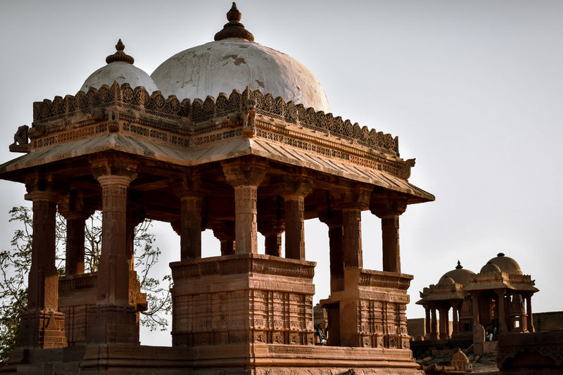 Low angle view of tomb against clear sky. chatardi, kachchh, gujarat