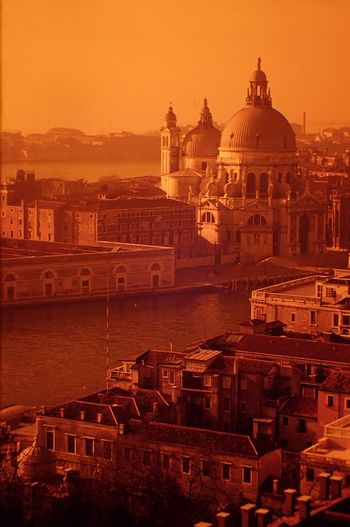 Santa Maria Della Salute By Grand Canal In City During Sunset