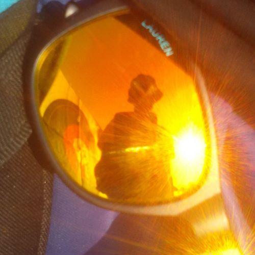 Close-up of illuminated orange reflection