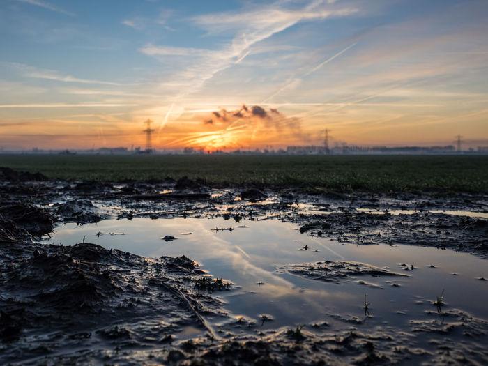 Cloudscape Copy Space Industry Netherlands Terneuzen Zeeuws Vlaanderen Beauty In Nature Cloud - Sky Day Energy Europe Field Landscape Nature No People Outdoors Pollution Scenics Sky Sun Sunrise Sunset Tranquil Scene Tranquility Water Zeeland