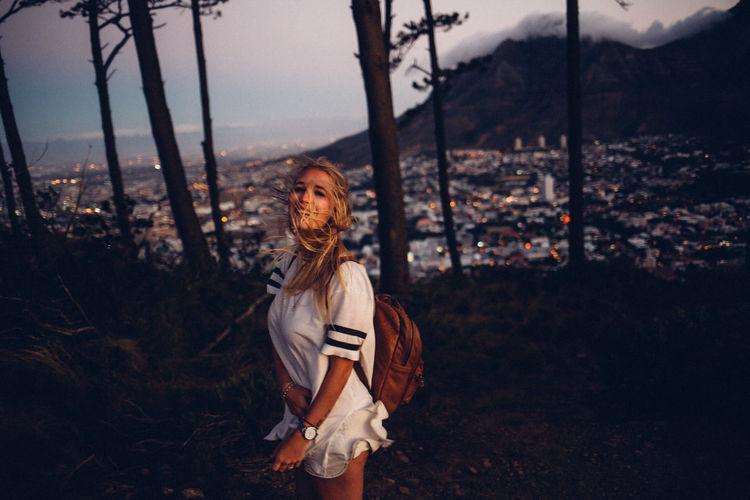 Portrait Of Woman Standing Against Cityscape