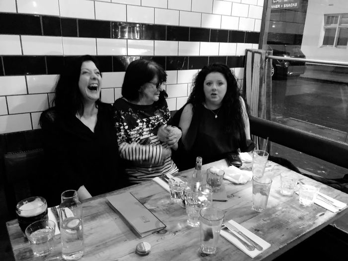 Mother And Daughters Family Time Three Generation Family Three Generetion Of Woman Friendship Real People Table Lifestyles Women Indoors  Portrait Females Togetherness Restaurant
