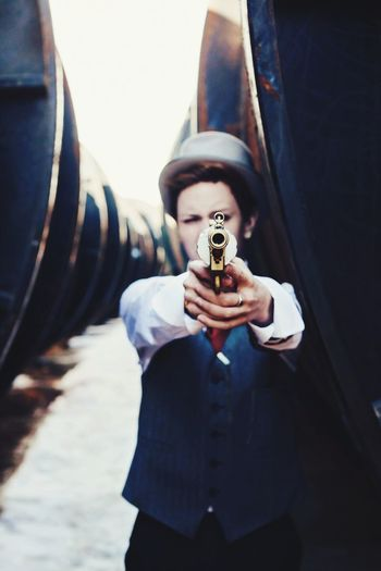 Well-Dressed Man Pointing Gun By Steam Train