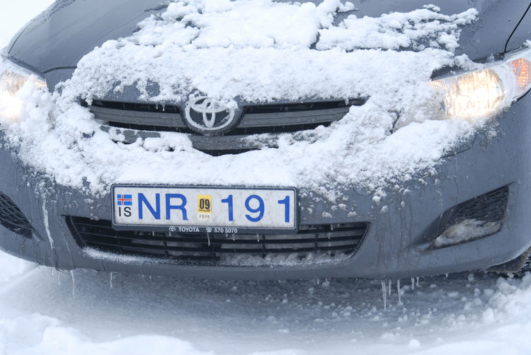 Close-up of snow covered car