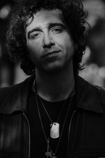 Singer  Blackandwhite Black And White Shadows & Lights Black & White Portrait Front View One Person Headshot Lifestyles Casual Clothing The Portraitist - 2018 EyeEm Awards Real People Looking At Camera Human Face Looking Curly Hair Young Adult