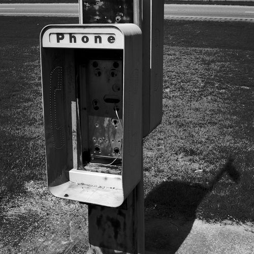 Close-up of old telephone booth