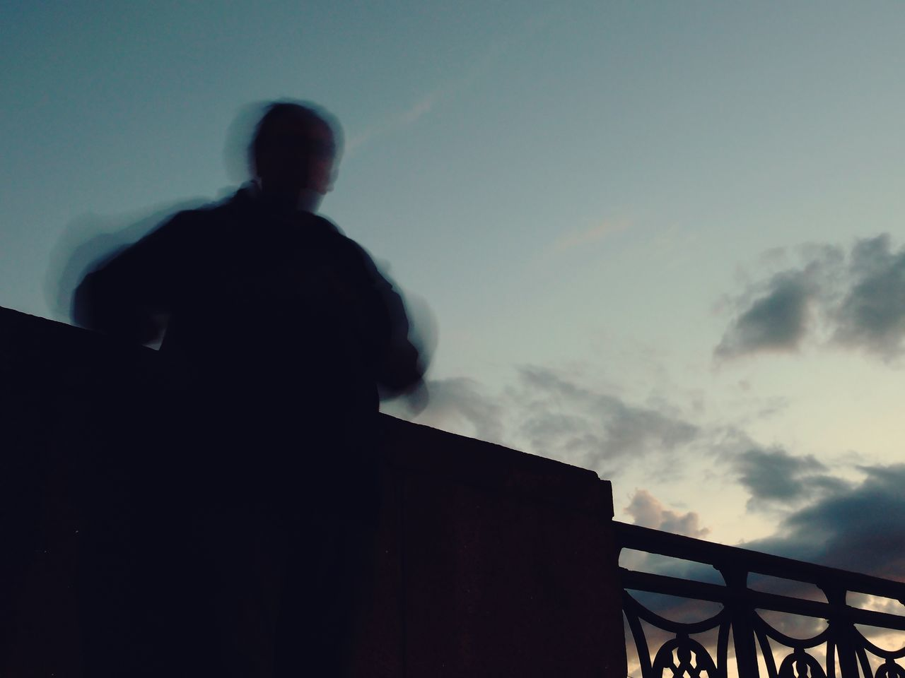 Blurred Motion Of Silhouette Man Against Sky