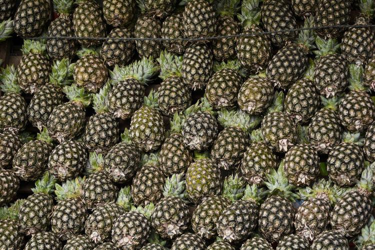Full frame shot of pineapples at market stall
