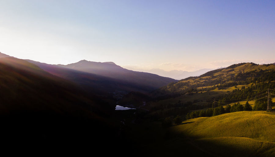 Golden hour in Vars Drone  France Alps Beauty In Nature Clear Sky Copy Space Drone Photography Dronephotography Droneshot Environment Idyllic Land Landscape Lens Flare Mountain Mountain Peak Mountain Range Nature No People Non-urban Scene Outdoors Remote Scenics - Nature Sky Sunlight Sunset Tranquil Scene Tranquility Vars
