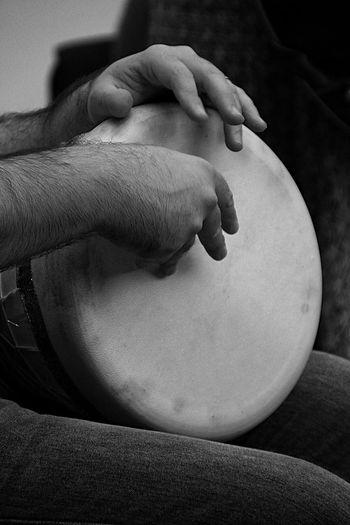 Close-up of man playing a percussion instrument