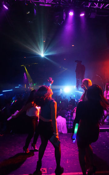 Arts Culture And Entertainment Celebration Crowd Enjoyment Event Girls Night Out Illuminated Large Group Of People Leisure Activity Lifestyles Lighting Equipment Music Night Night Out Nightlife Performance Togetherness Women Women Dancing Women Dancing Together