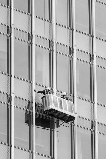 Low angle view of worker outside glass building