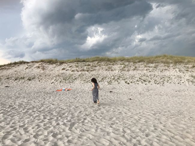 Woman Cloud - Sky Sky Land Leisure Activity Real People Beach Nature Sand Lifestyles Beauty In Nature Day One Person Tranquil Scene Outdoors Tranquility Scenics - Nature
