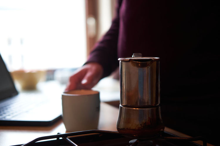 Midsection of coffee cup on table