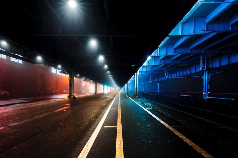 Empty railroad tracks at night