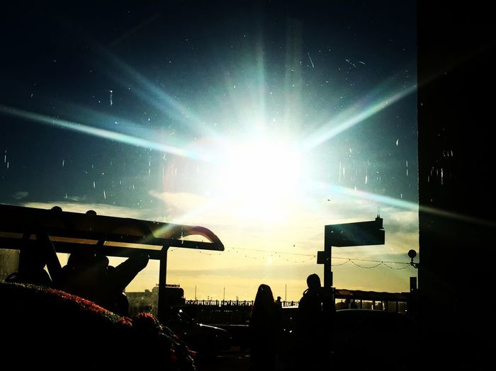 Sea Front Sussex Worthing Sunbeam Sun Sky Lens Flare Silhouette Sunlight Real People Outdoors Nature Light Beam Colour Your Horizn Capture Tomorrow
