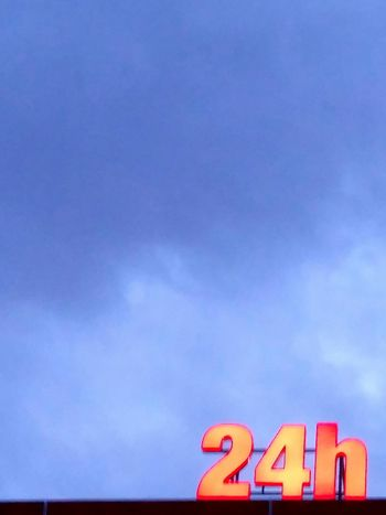 24 hours Blue No People Text Outdoors Sky Day Non Stop  24 Day And Night City City Life Adapted To The City EyeEmNewHere The City Light Minimalist Architecture Millennial Pink Art Is Everywhere EyeEm Diversity The Secret Spaces Stories From The City