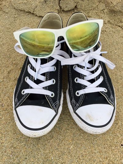 Reflection Summer Beach Shoe Sunglasses Day Outdoors Converse Ocean Sand Pair California Beach Life Huntington Beach Sunny Close-up No People Black Converse Sommergefühle High Angle View The Great Outdoors - 2017 EyeEm Awards California Dreamin Summer Exploratorium