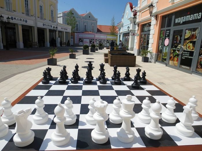 parndorf factory outlet Chess Chess Piece Chess Board Leisure Games Strategy People Architecture Day Adult Consumerism Store Business Austria Parndorf