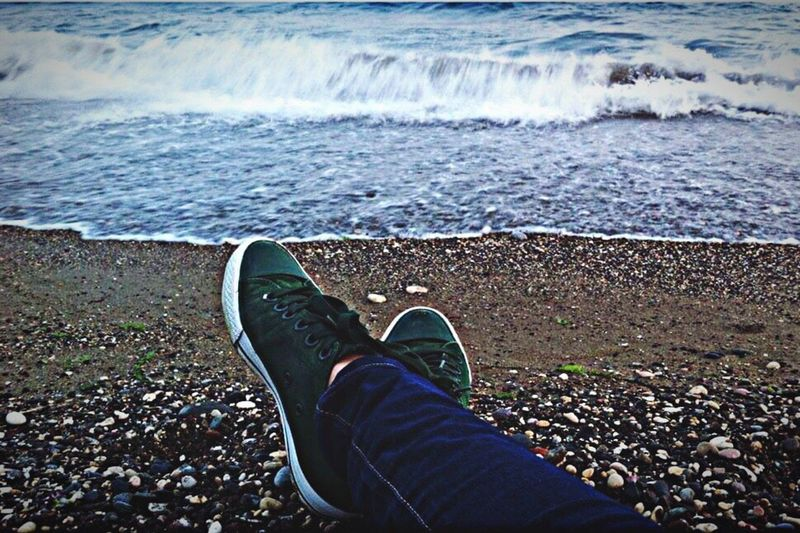 Low Section Person Water Sitting Personal Perspective Shoe Relaxation Footwear Sea Human Foot Day Resting Tranquility Tranquil Scene Outdoors Vacations Shore Non-urban Scene