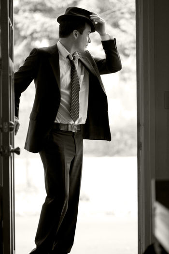 Man Handsome Suit Hat Door Doorway Greet Greetings Style Stylish Black And White