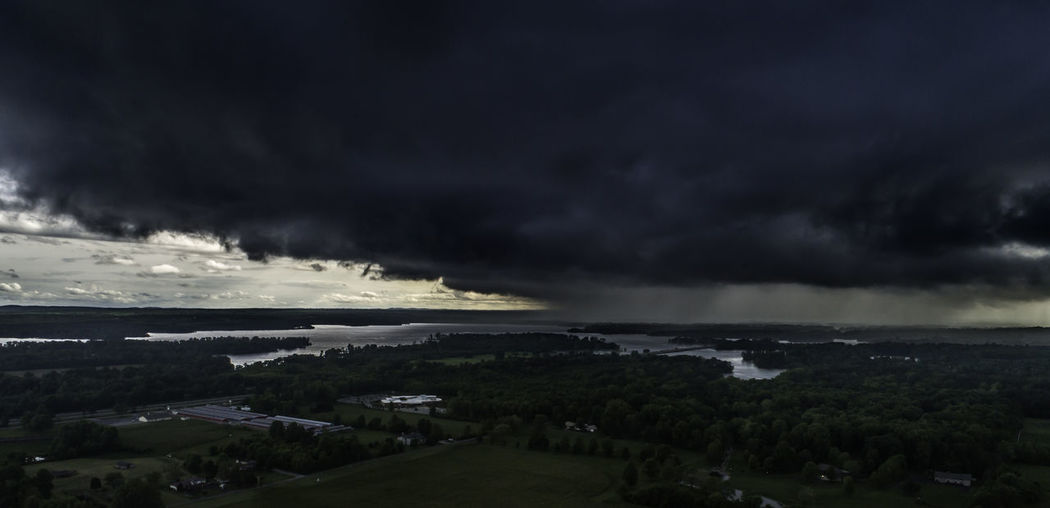 Dramatic storm clouds race over Crab Orchard Lake in-between Carterville and Carbondale, Illinois on a spring afternoon. Cloud - Sky Sky Storm Storm Cloud Beauty In Nature Overcast Scenics - Nature Nature Architecture Sea No People Water Building Exterior Built Structure Environment Thunderstorm Dramatic Sky Dusk Outdoors Ominous Power In Nature Aerial View Aerial Photography Aerial Drone  Drone Photography Dji Dji Phantom Illinois Carterville Carbondale, Illinois Carbondale Storm Storms Stormy Weather Weather Weather Condition Rural Scene Rural Rural America