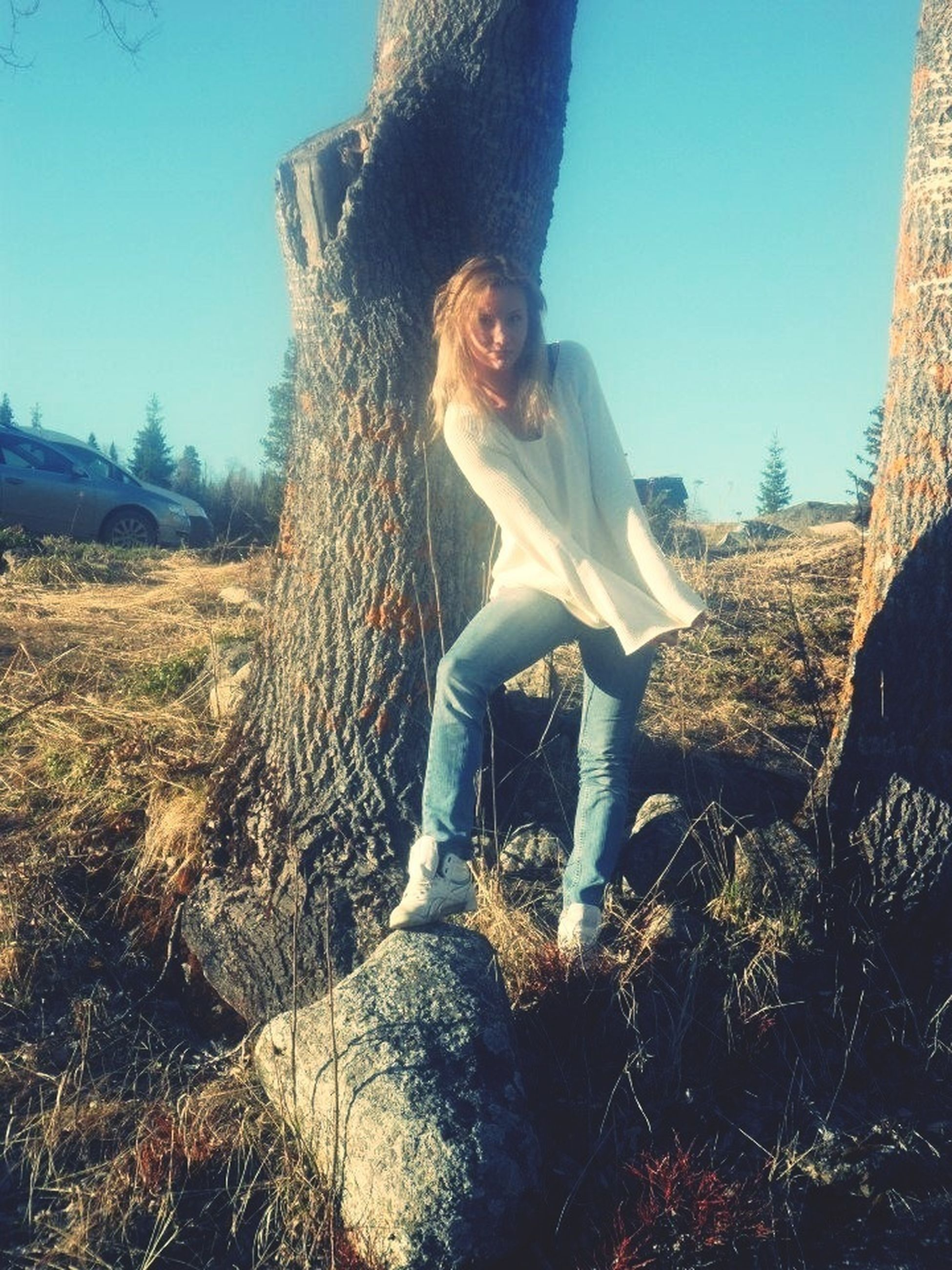 lifestyles, leisure activity, young adult, clear sky, casual clothing, standing, sunlight, full length, young women, tree, person, front view, day, three quarter length, low section, looking at camera, nature, portrait